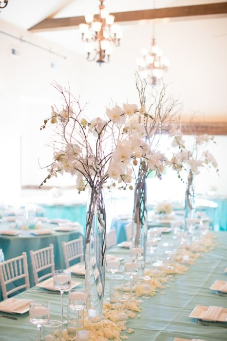 Orchid, crystal, silver manzanita and candle tall centerpiece
