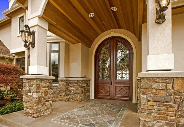 Image of Beautiful Double Doors for Front Entrance with Decorative Wrought Iron Grills Below Recessed Led Lighting on Front Porch Ceiling Using Mahogany Wood Planks also Entryway Corner Bench Hallway Wall Storage Entryway Candle Stand