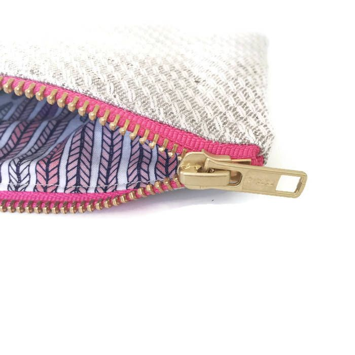 This environmentally friendly small zipper coin purse would be great for keeping your coins, cards and other small items in. Ideal size for keeping in you beach bag. • British woven organic hemp-cotton coin purse • Measures 15 x 11cm (6 x 4 inch)  • Cloud 9 'Plumes Lavender' 100% organi