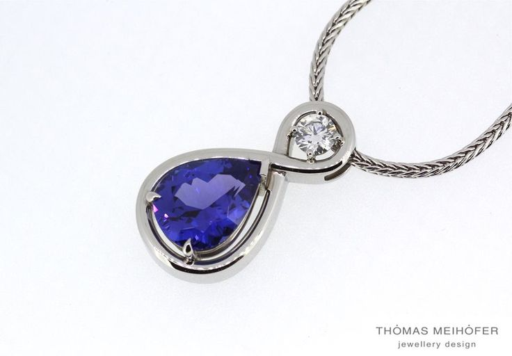 Lovely Tanzanite and diamond pendant set into platinum… What better way to show the one you love just how much you love them than with an eternity symbol wrapped around a tanzanite and diamond? This is one very lucky lady.