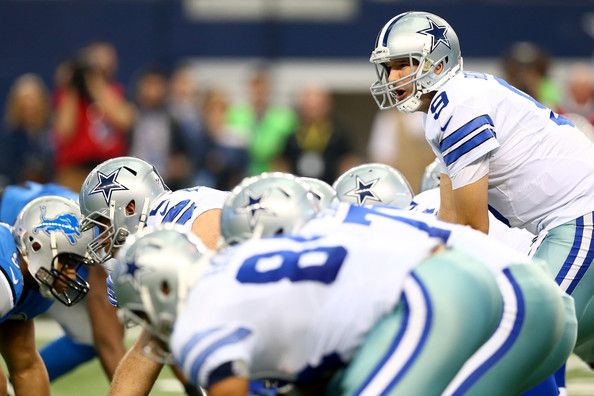 Tony Romo Photos Photos - Quarterback Tony Romo #9 of the Dallas Cowboys looks on in the first quarter while under center against the Detroit Lions during the NFC Wildcard Playoff Game at AT&T Stadium on January 4, 2015 in Arlington, Texas. - Wild Card Playoffs - Detroit Lions v Dallas Cowboys