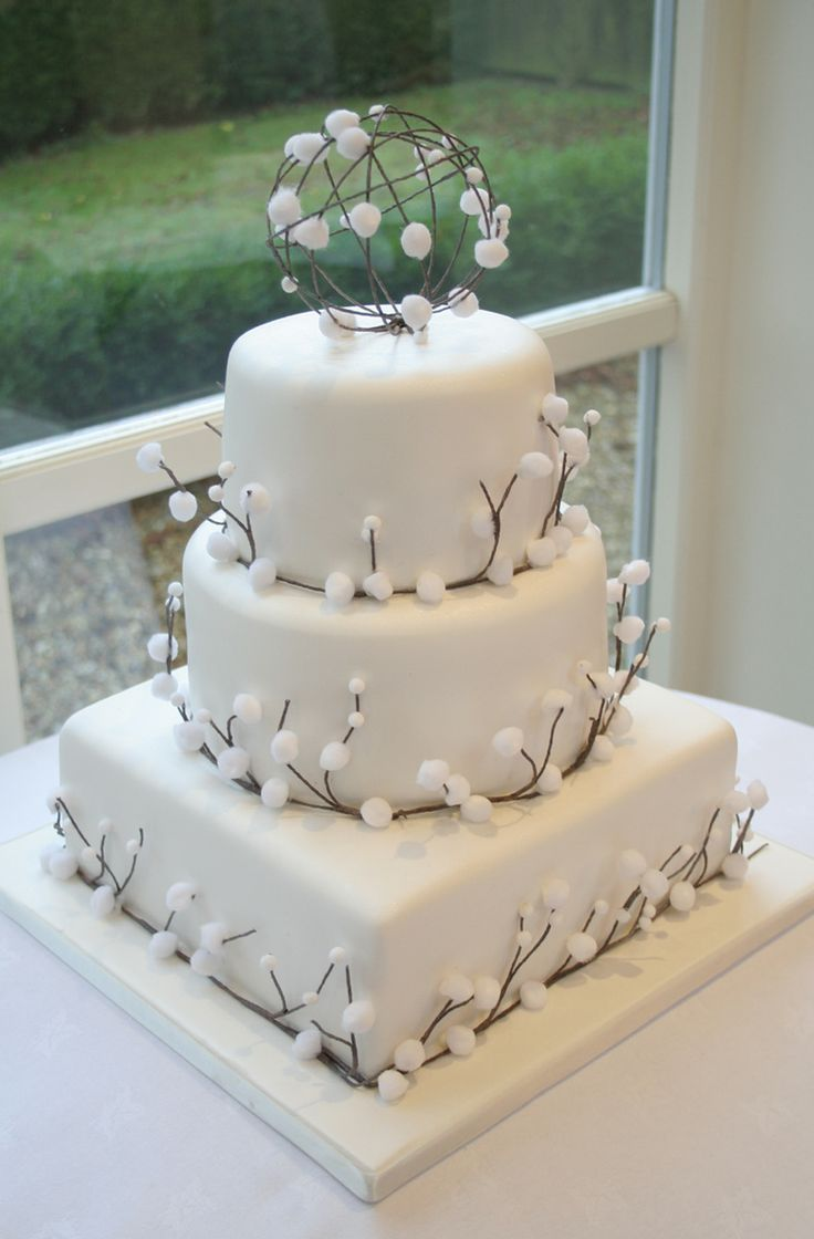 A winter wedding provides the perfect theme for something a little different and this cotton bush inspired wedding cake with sphere topper matched the couples natural theme perfectly.