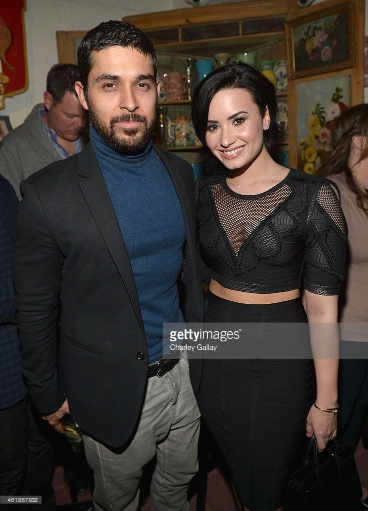 Wilmer Valderrama and Demi Lovato celebrate Nick Jonas' song 'Jealous' being the #1 At Top 40 radio hit at The Ivy on January 20, 2015 in Los Angeles, United States.