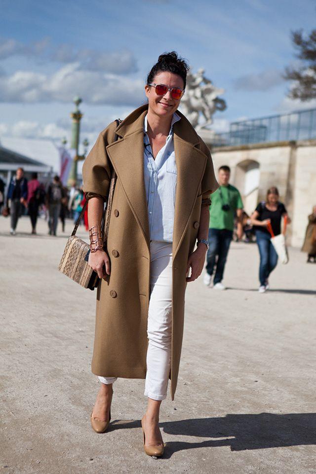 Garance Dore street style during Paris fashion week - camel, oversized Stella McCartney coat, white jeans, nude pumps, washed shirt.