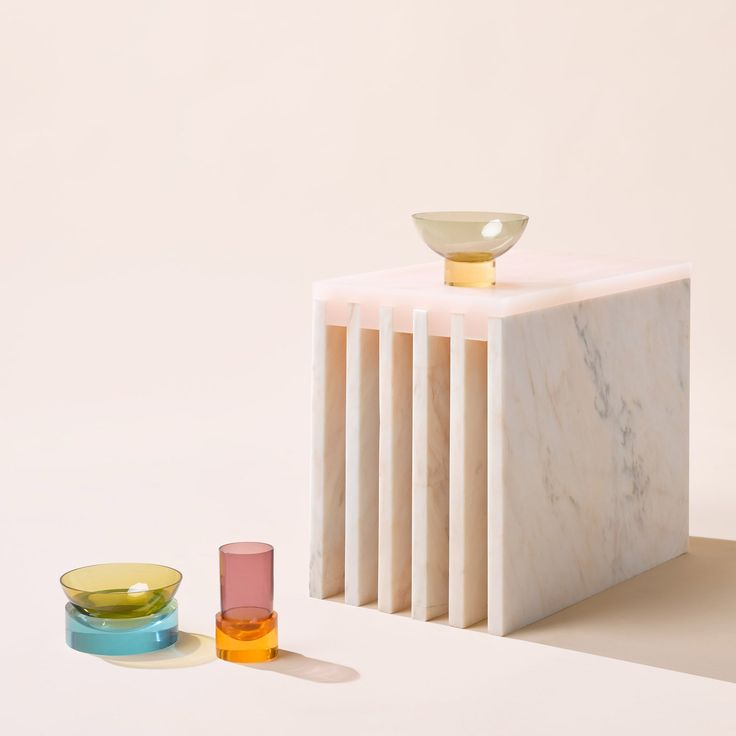 Marble tables, coloured glass vases and bowls, and mirrors with concrete bases are among pieces by design studio Objects of Common Interest on show at New York gallery Matter.