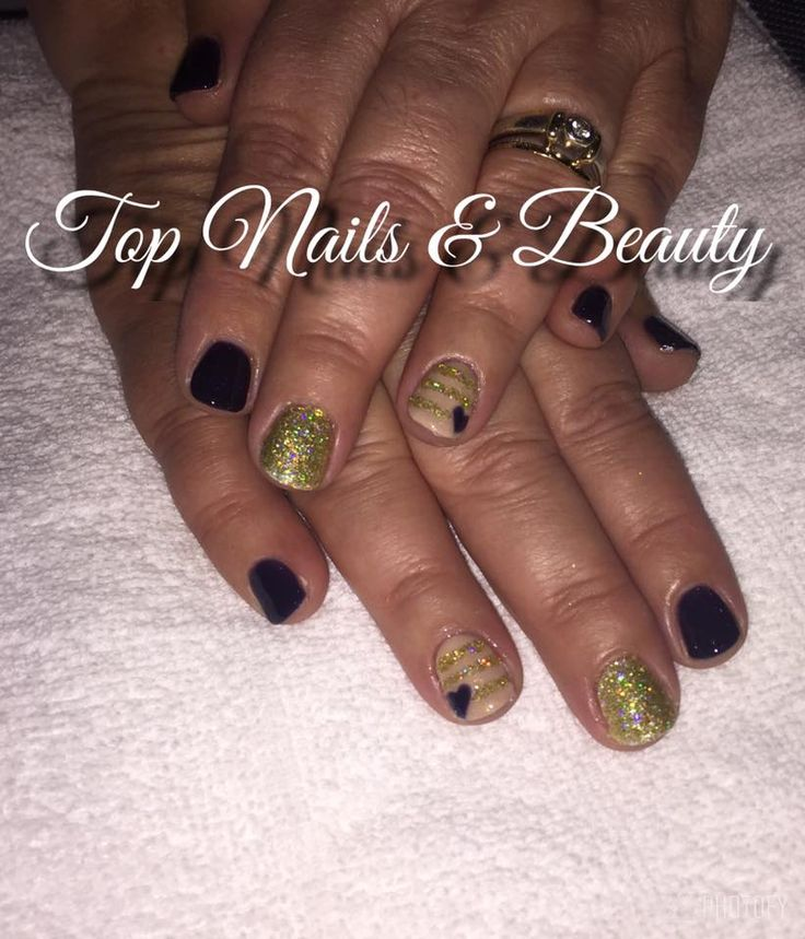 navy nails with nude and gold