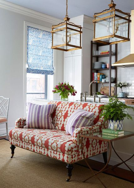 A Colorful, Neo-Trad Apartment in Chicago: A range of different metal finishes appear throughout the home—in gilded antique pagoda lanterns and polished-nickel faucets and brass sconces—for a quirky, curated feel.