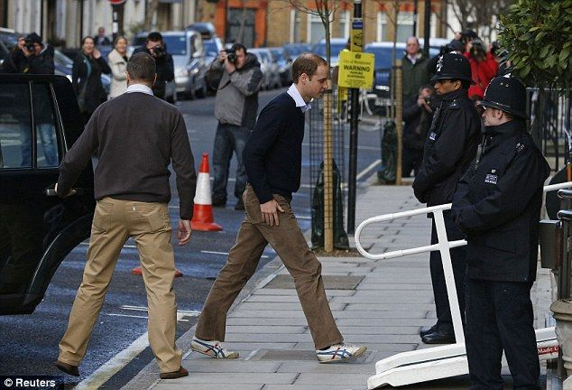Supportive husband: Prince William (centre) arrives at the King Edward VII Hospital yesterday to visit Kate
