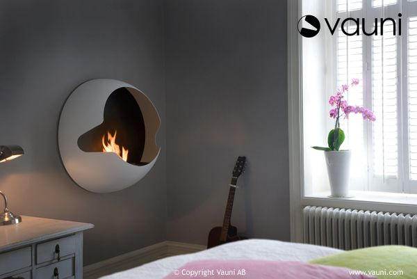 I like this fireplace a lot. It's flueless and burns using bio-ethanol. You can just by the burner and create your own design as well.