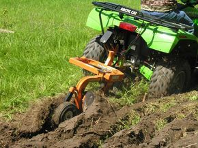 http://www.off-road.com/aimages/articlestandard/atv/282006/358139/article.html : Till up a plot with this ATV attachment
