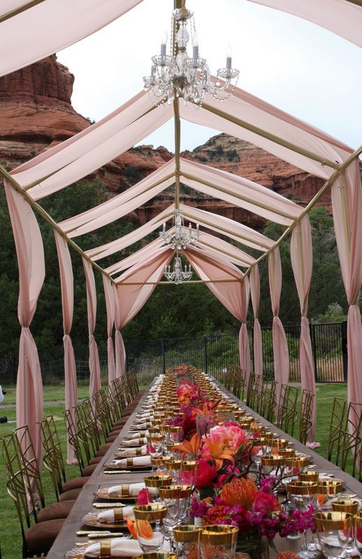 Are you dreaming of an outdoor affair with a breathtaking or exotic landscape? Outdoor weddings and events are enchanting and anything you dream up can be created! This stunning local was perfect for the open air tent we created with banquet style tables ensconced in whisps of airy fabric and lit with opulent chandeliers. It defines the space without making if feel closed in or claustrophobic. In this case weather was not a concern. However, if you love this look and want to create a…