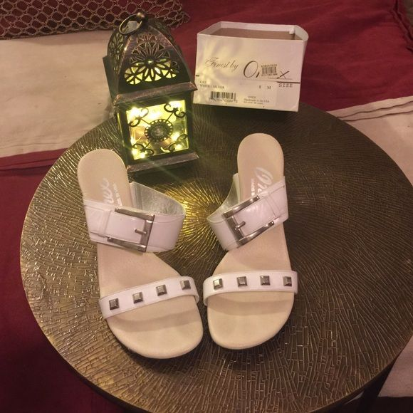 Onex sandals size 8 white with studs Studded Onex sandals new never worn but silver has small scratches, notice on pictures. Runs small so if your a 7 or 71/2 will fit. Onex Shoes Heels