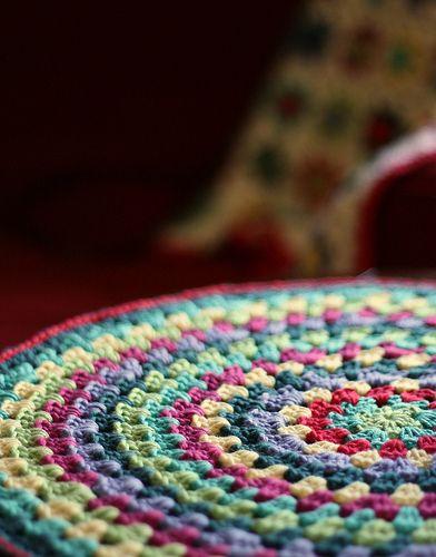 Crocheting in circles... Free pattern here: http://crochethealingandraymond.wordpress.com/2010/11/11/revisiting-the-granny-mandala/