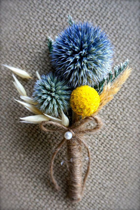 Boutonnieres: two blue thistle, one yellow billy balls, wild oats, wild grass and green caspia