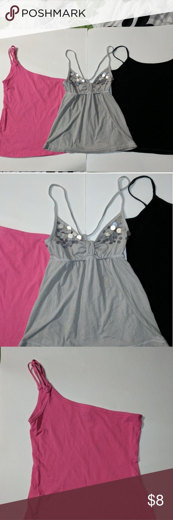 Set of Three spaghetti strap tanks Size M This is for set of three summer tops for ladies all are size mediums.  Pink one shoulder strap is Wet Seal brand Gray silver sequins string top is Abercrombie New York brand Solid black tank is Aeropostale favorite Cami brand All are in good condition see photos for detail comment with any questions. Aeropostale Abercrombie Wet Seal Tops Tank Tops
