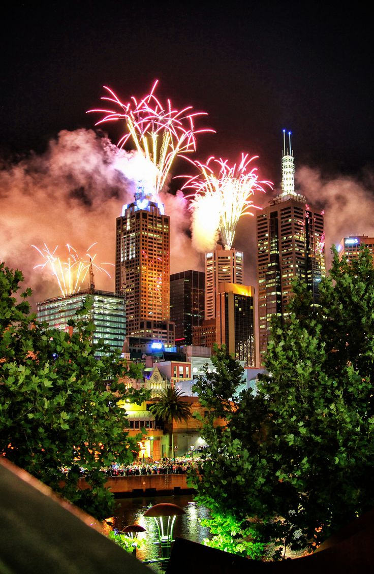 Over the cityscape of Melbourne, Australia, fireworks light up the sky