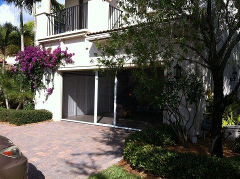 a garage screen door can be a visual barrier letting in the outside air and light