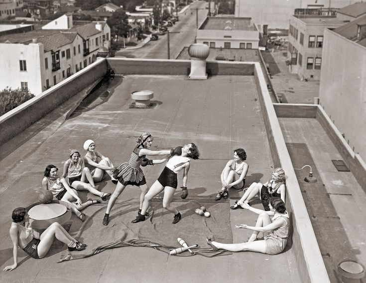 Women boxing on a roof.  1930s