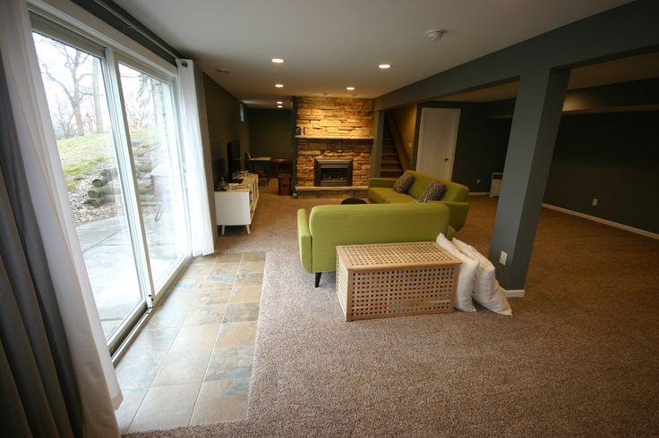 Simple Basement, carpeting, drywall ceiling, recessed lighting,white trim, basement kids playroom, tile walk-out