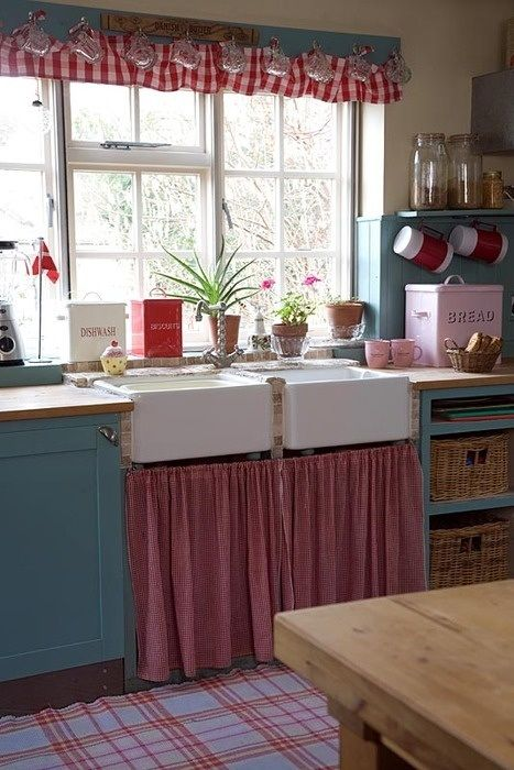 Cute retro kitchen. Don't really like the blue but I love the farmhouse sink and the curtains...ideas a brewing