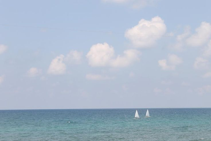 Photo of two sailboats along the seaside