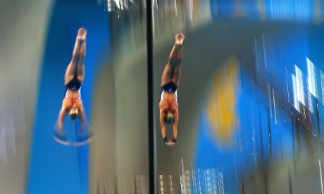 Arms together on the left. Barrow and Tonia Couch of Great Britain compete during the Women's Synchronised 10m Platform final at the Aquatics Centre