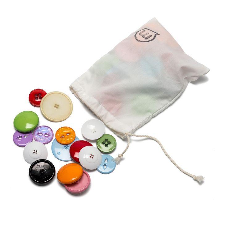 Botons de diferents colors de mida gran. Per a l'experimentació sensorial, el joc heurístic i altres moltes propostes.