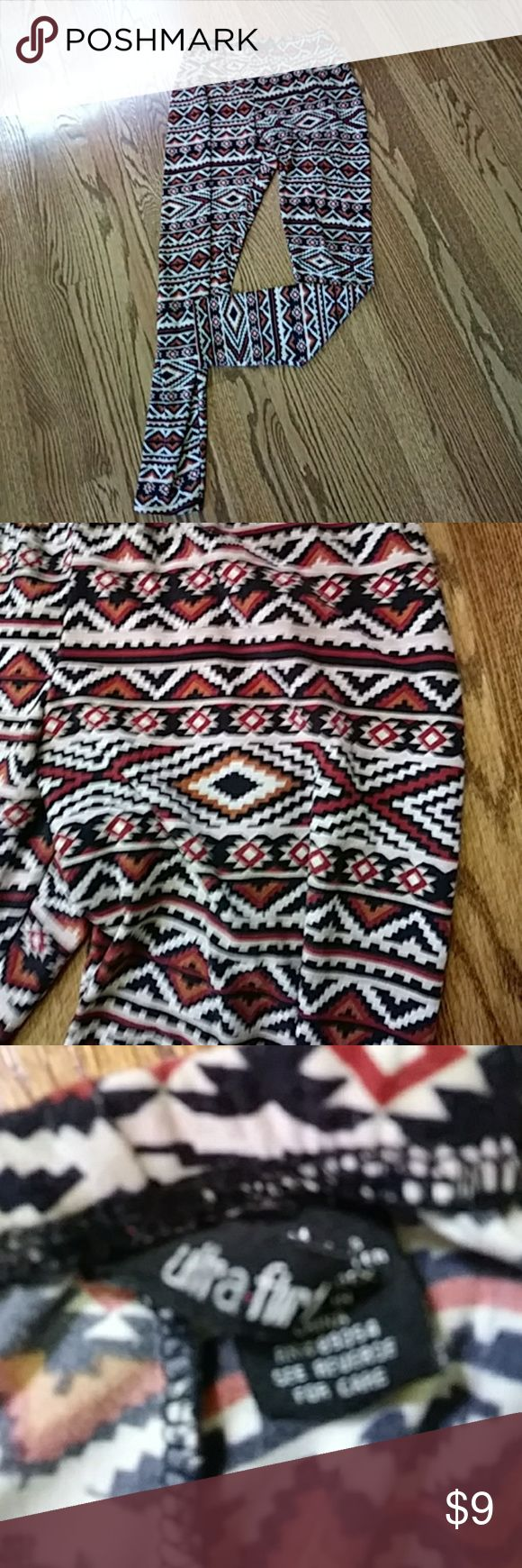 Aztec print soft leggings 50% off bundles Aztec printed neutral colors with burgundy black and whites. Like new condition worn maybe twice! Super soft, skinny style leggings. Polyster and spandex elastic waist line Ultra Flirt Pants Leggings