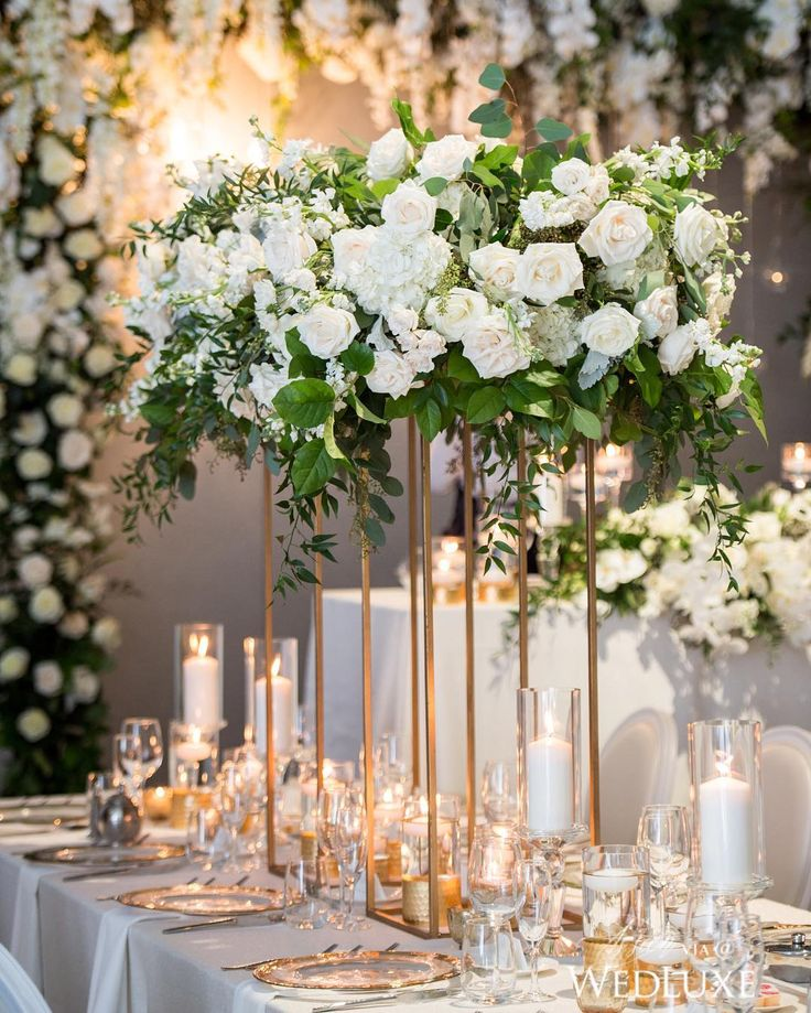 White florals, metallic gold accents, and flickering candles make up this breathtaking #tablescape. See more on WedLuxe.com (: @amsisphotography, coordination: @itsyourdayweddingsandevents, decor & floral: @coverscouture, venue: @chateau.le.parc)