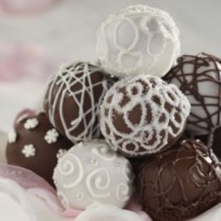 Red Velvet Cake Balls: The ever-so-popular trend of cake, crumbled and mixed with frosting, then rolled into bite-sized balls and coated in chocolate! Find out why they are so popular!