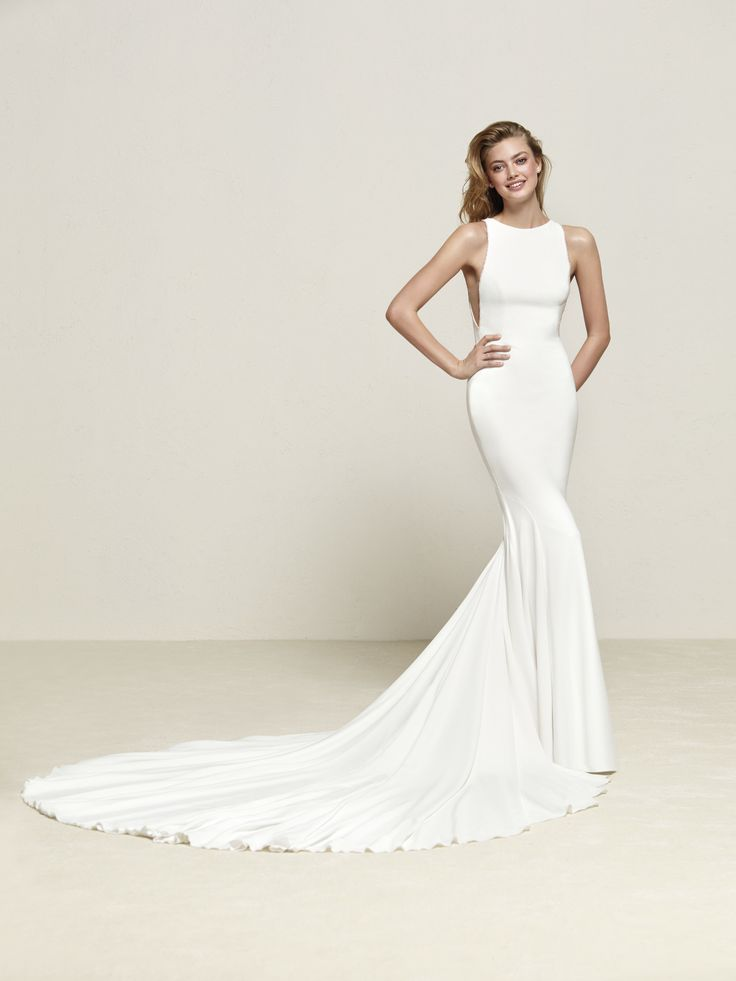 Driosa: Simply radiant. This mermaid wedding dress with large train in crepe and tulle will leave you breathless - Pronovias