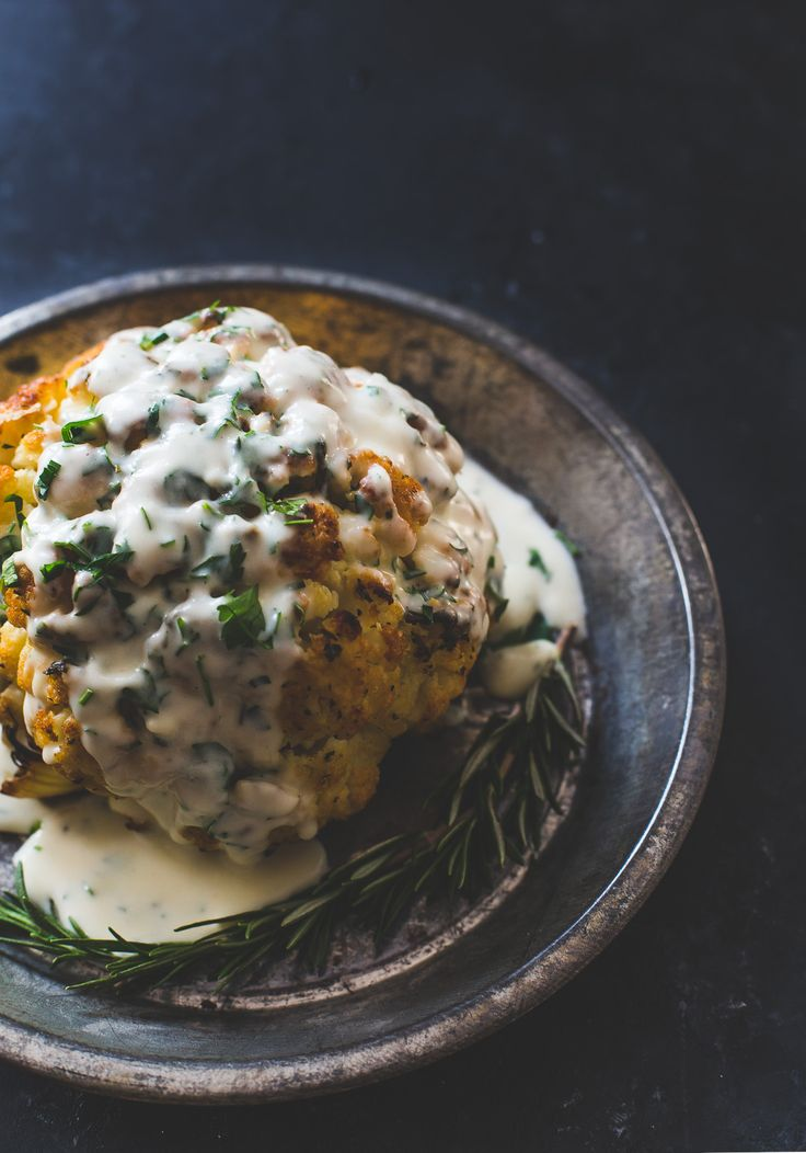 the best whole roasted cauliflower recipe, with fontina cheese sauce. -- sponsored by @rothcheese