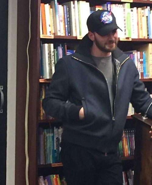 Chris Evans with a fan at the Brookline Booksmith.