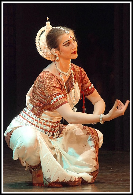 Odissi is a devotional dance form originating in the temples of ancient India. Curvaceous movements, sculptured poses, fluid grace, and impeccable rhythm characterize this vibrant art.