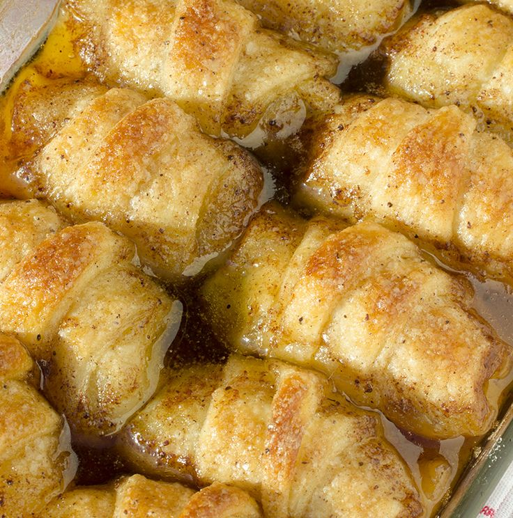 Easy Apple Dumplings -2 (8 ounce) cans crescent rolls 2 sticks butter 1½ cups brown sugar 1 teaspoons vanilla 1 teaspoon cinnamon 1 ½ cup 7 Up (or other lemon soda) 2 apples (Golden Delicious or Granny Smith)