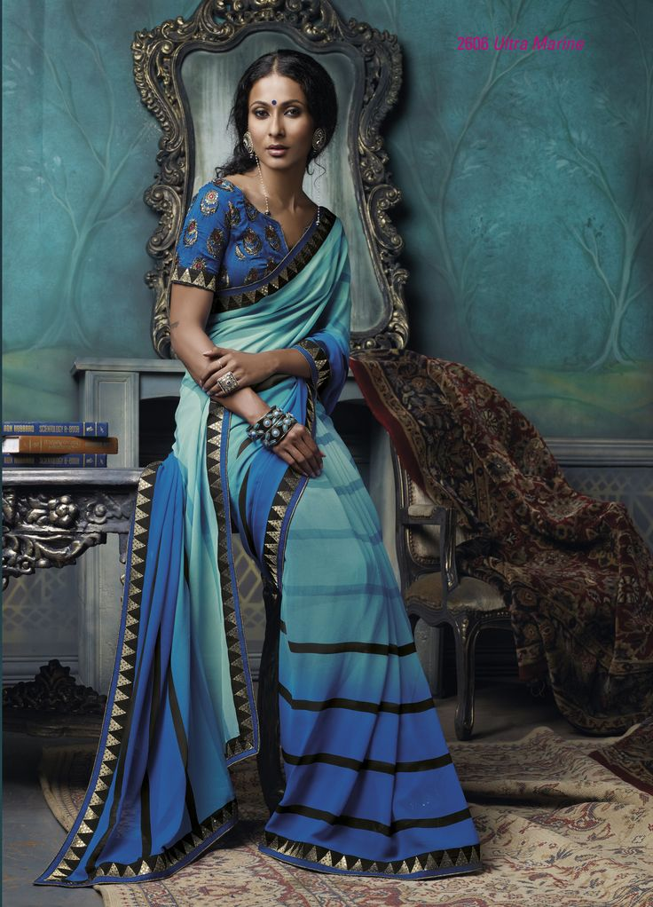 Combination Of Blue, Black & Sky Blue color printed Georgette material saree with beautiful embroidered border & blouse piece