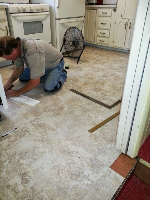 Hard At Work Installing A New Duraceramic Luxury Tile
