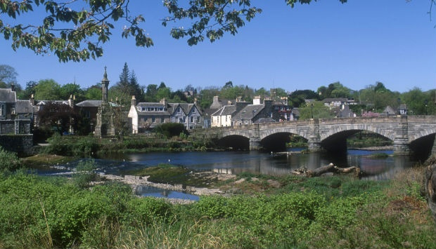 across the water to the bridge and houses of Newton Stewart
