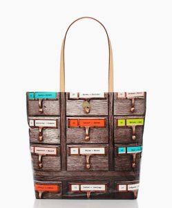 Kate Spade library collection, Kate Spade I have never wanted a designer purse, but I'll definitely take this one!