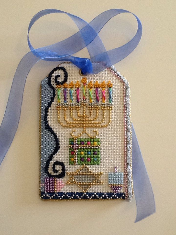 Pamela M. stitched this nice menorah gift tag. The beading is beautifully done. Nimble Needle Atlanta is the shop.