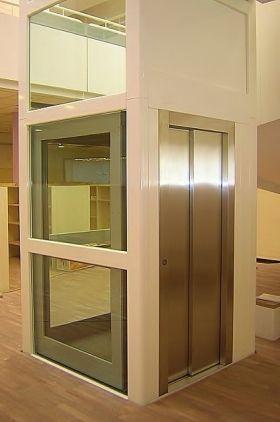 Lux+ - Ascenseur Monte escalier DIJON  Mini ascenseur avec portes automatiques coulissantes... Mini ascenseur avec portes automatiques à effacement latéral ou central. Le plaisir et le luxe d'un vrai ascenseur au prix mini! Une large gamme de dimensions standards à télécharger. Pour une dimension spécifique, merci de nous consulter.