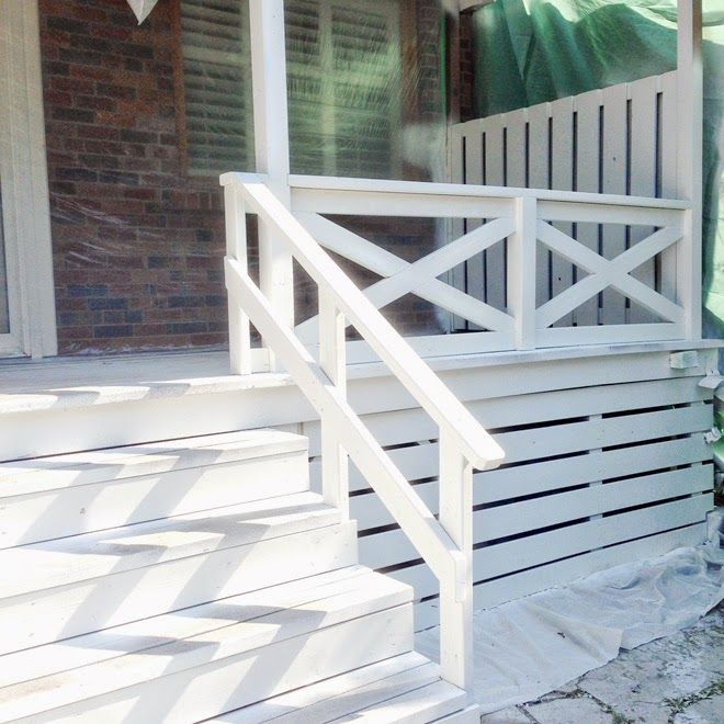 Back deck covered porch white x cross railing curb for Front balcony railing