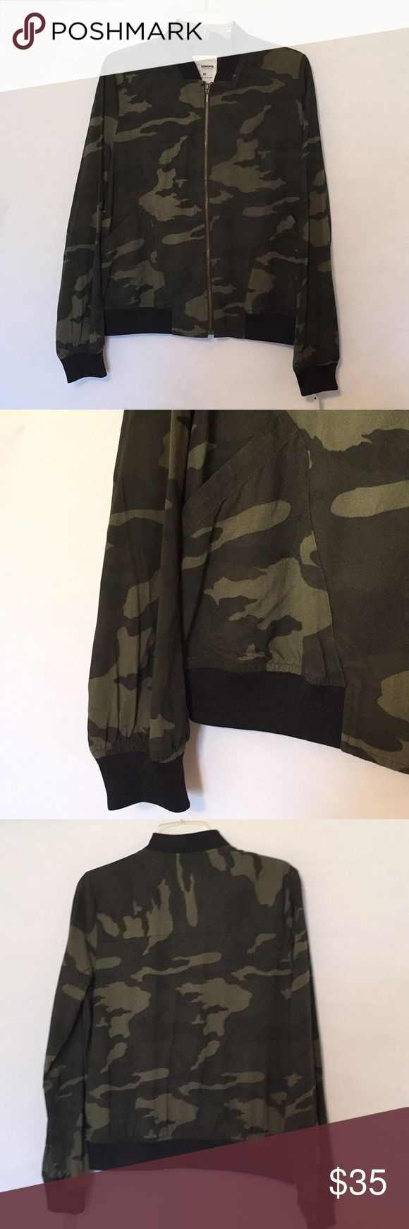 """🆕 Camo bomber jacket Sonoma green camo bomber jacket, black stretch cuffs, neck and bottom. Zip front with brass hardware, two front pockets. Measurement across chest laying flat: 21"""" for Medium, 22"""" for Large. 100% rayon, unlined. Perfect weight for spring/fall. Sonoma Jackets & Coats"""
