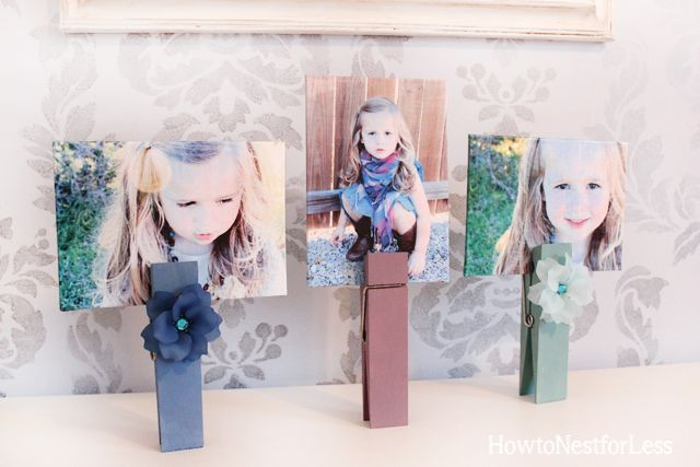 Decorating with Pictures at How to Nest for Less.  Oversized clothespin picture holders.