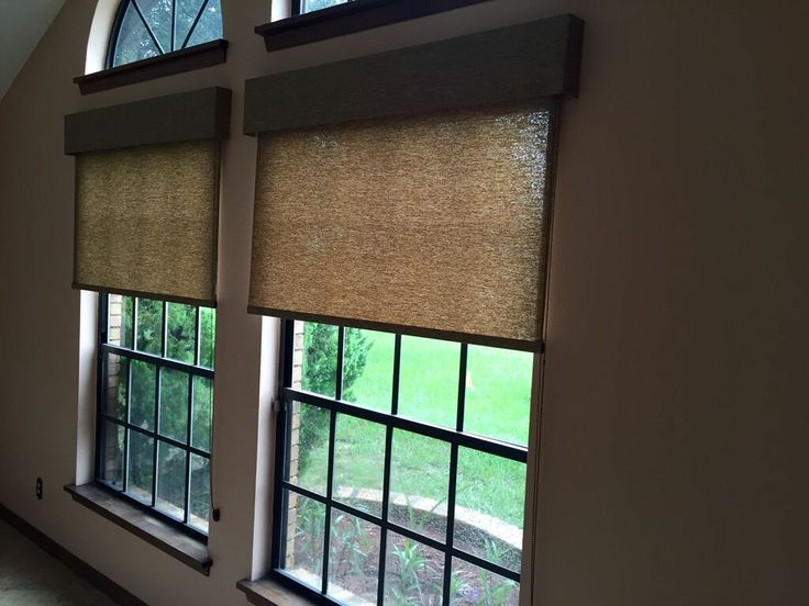 Light filtering roller shades with a traditional valance add elegance to the family room