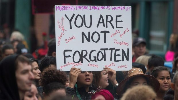 People march through the Downtown Eastside during the 25th annual Women's Memorial March in Vancouver in February, to honour missing and murdered women and girls from the aboriginal community.