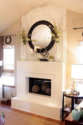 I totally have this huge round black mirror and need to put it somewhere! I has been wondering my house for years!