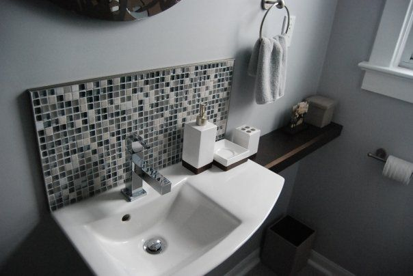 The stone and glass mosaic tile was too expensive so let's just use it here and keep the rest of the bathroom clean. The Vitra sink was an interesting find. Scoured the city for something small that would fit but still have counter space.