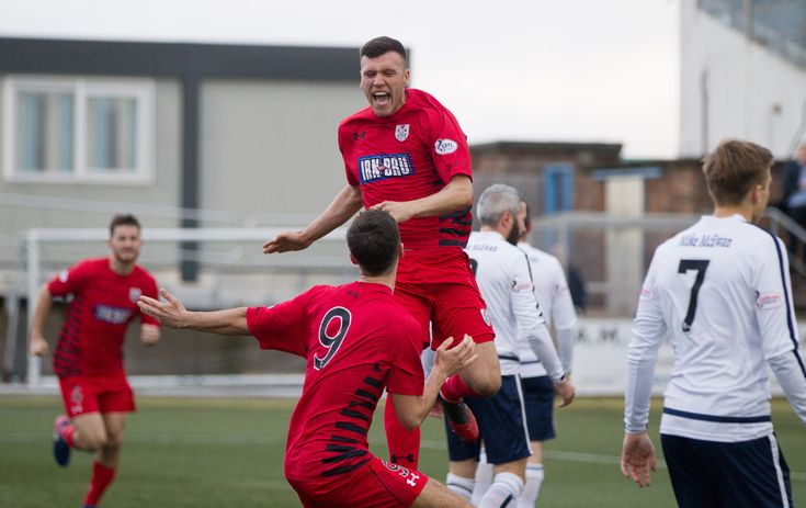 Queen's Park's Adam Cummins celebrates his goal during the SPFL League One game between Forfar Athletic and Queen's Park.