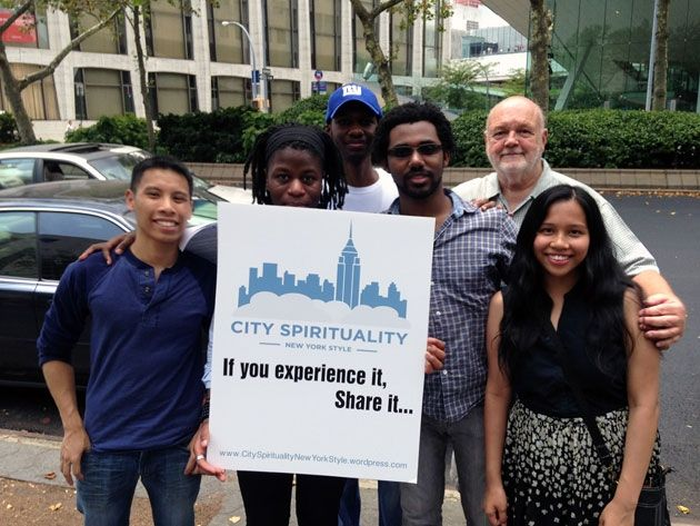 Father John Collins, CSP (back row, right) and some friends spread the word about City Spirituality on the streets of New York.